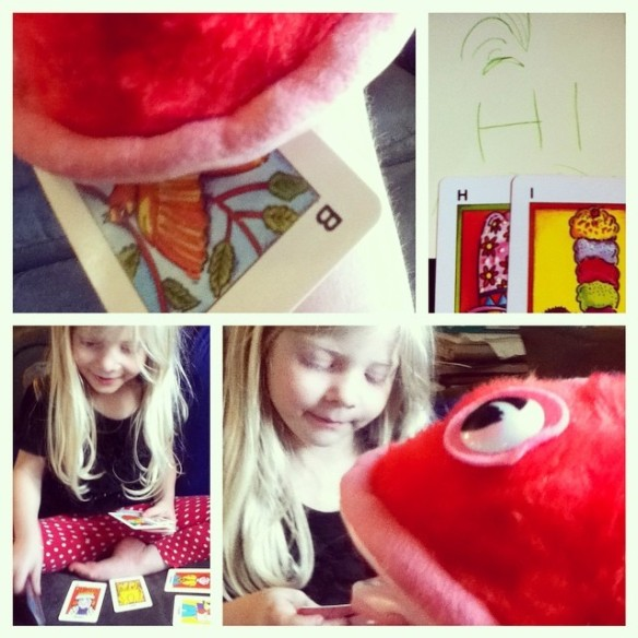 Today's reading practice. Fiona has asked me to do more all day. I just made a game of feeding letter cards to a fish puppet I found to help him spell words. We also are spelling words with the cards and she wanted to write the words.